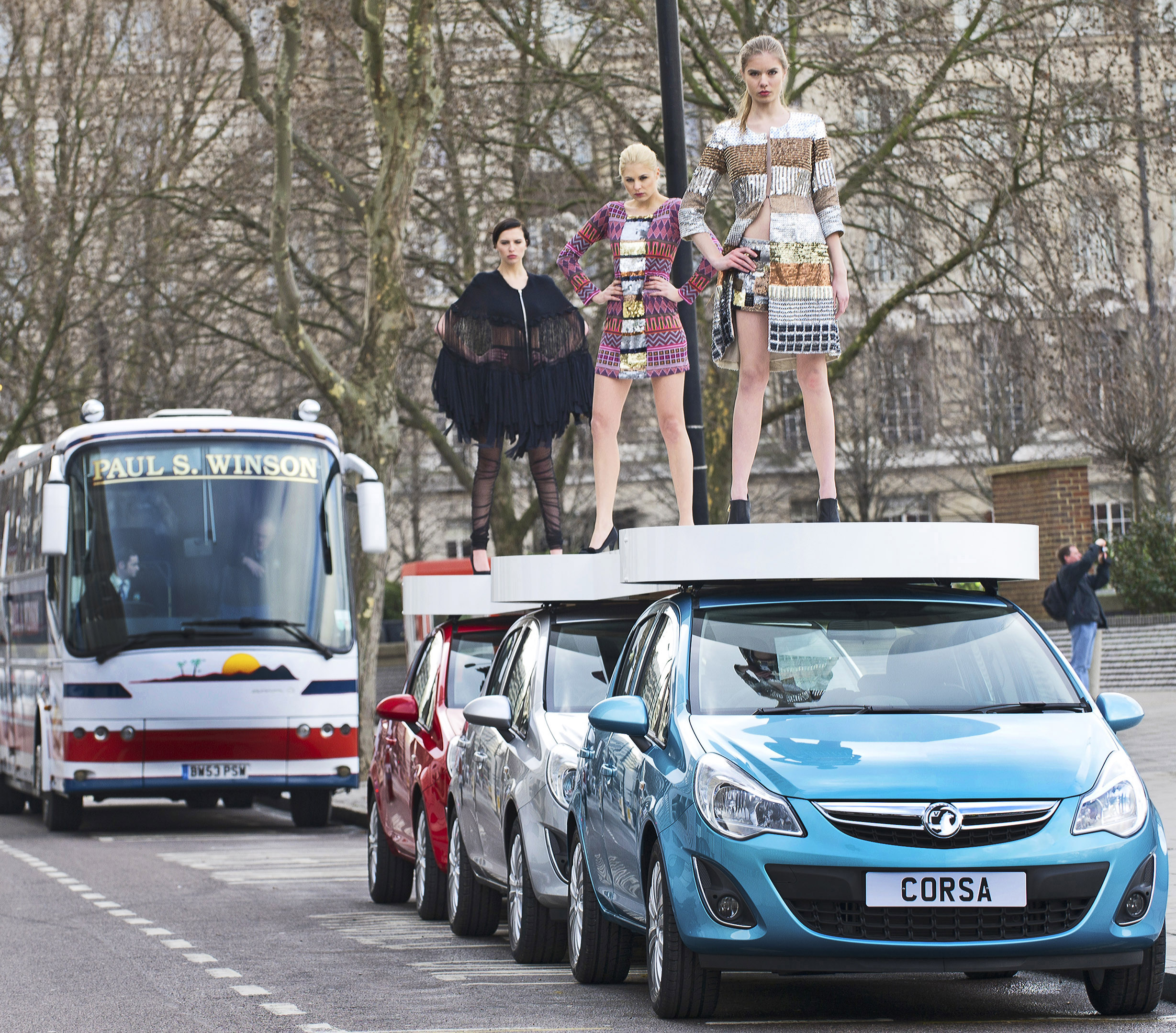 Models mount motors on world's first car-walk